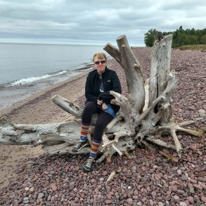 Me sitting on a huge piece of driftwood in Michigan's Keweenaw peninsula